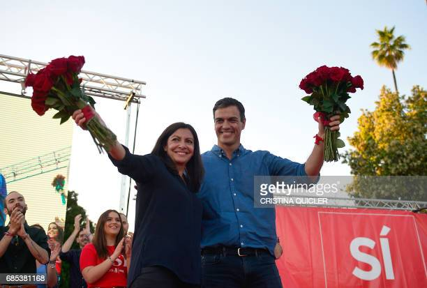 Candidate for Secretary General of the Spanish Socialist Party Pedro Sanchez and mayor of Paris Anne Hidalgo wave at the end of a political meeting...