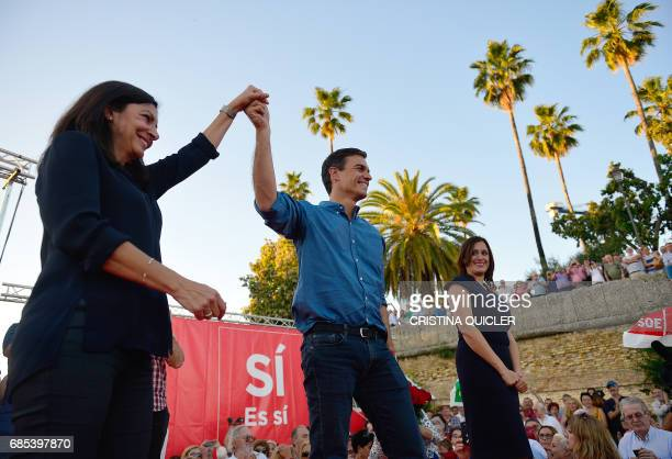Candidate for Secretary General of the Spanish Socialist Party Pedro Sanchez and mayor of Paris Anne Hidalgo hold hands at the end of a political...