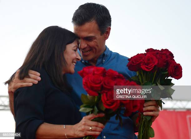 Candidate for Secretary General of the Spanish Socialist Party Pedro Sanchez talks to mayor of Paris Anne Hidalgo at the end of a political meeting...