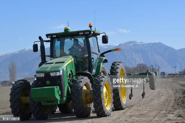 Candidate for senate Mitt Romney at the wheel of a John Deere tractor as he tours Gibson's Green Acres Dairy on February 16 2018 in Ogden Utah Mr...