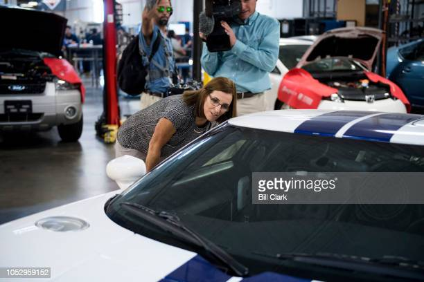 GOP candidate for Senate Rep Martha McSally RAriz looks at a Ford GT as she tours the Universal Technical Institute in Avondale Ariz outside of...