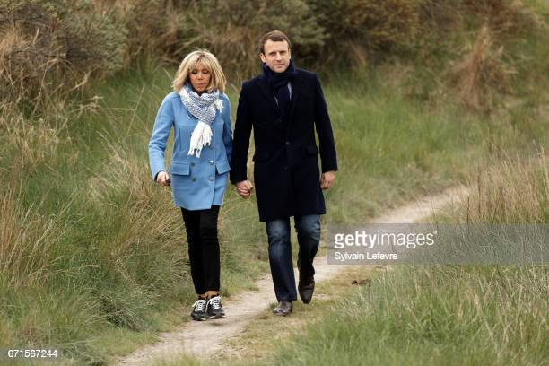 Candidate for the 2017 presidential election Emmanuel Macron and head of the political movement En Marche and his wife Brigitte Trogneux pose for the...