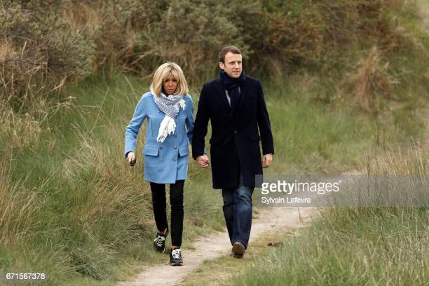 Candidate for the 2017 presidential election, Emmanuel Macron and head of the political movement En Marche! and his wife Brigitte Trogneux pose for...
