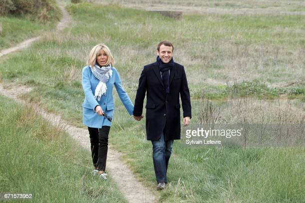 Candidate for the 2017 presidential election Emmanuel Macron and head of the political movement En Marche and his wife Brigitte Trogneux pose for a...
