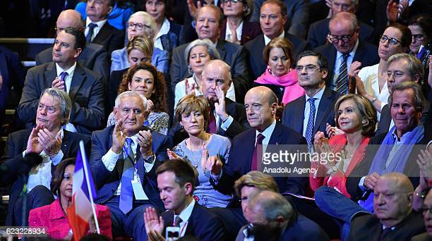 Candidate for the centreright presidential primary Alain Juppe French politician Valerie Pecresse and French actor Alain Delon attend a campaign...