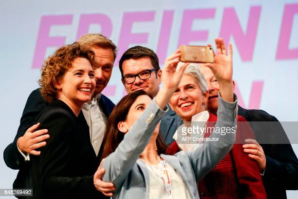 Candidate for the city of Hamburg Katja Suding takes a photo selfie during the party congress in Berlin on Sptember 17 2017 / AFP PHOTO / Odd ANDERSEN