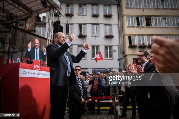 Candidate for the german chancellorship of the Social Democratic Party of Germany Martin Schulz gestures after a speech of his campaign rally on...