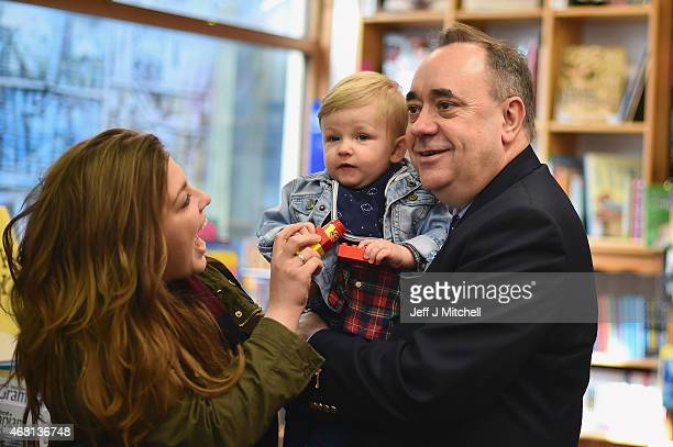 SNP candidate for the Gordon constituency Alex Salmond holds a child during the first day of the British General Election campaign on March 30 2015...