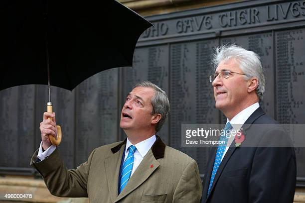 UKIP candidate for the Oldham byelection John Bickley and party leader Nigel Farage wander the city weeks before the byelection next month on...