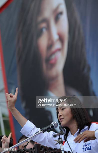 Candidate for the opposition Puea Thai party Yingluck Shinawatra the sister of former prime minister Thaksin Shinawatra holds up a finger as she...