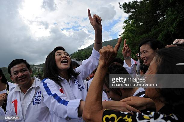 Candidate for the opposition Puea Thai party Yingluck Shinawatra the sister of former prime minister Thaksin Shinawatra holds up a finger during an...