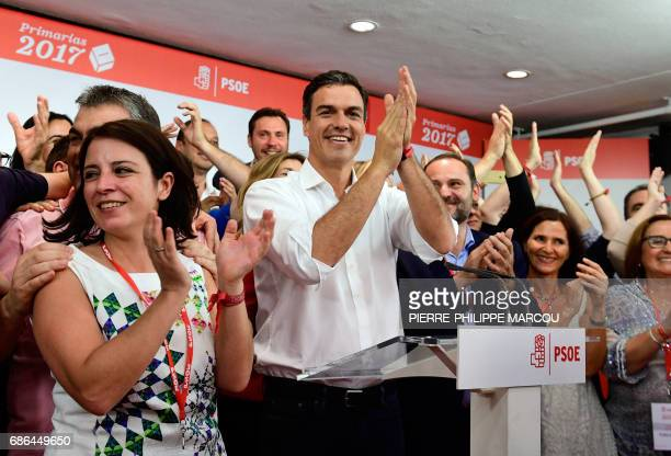 Candidate for the SecretaryGeneral of the Spanish Socialist Workers' Party Pedro Sanchez applauds at the party headquarters in Madrid on May 21 2017...