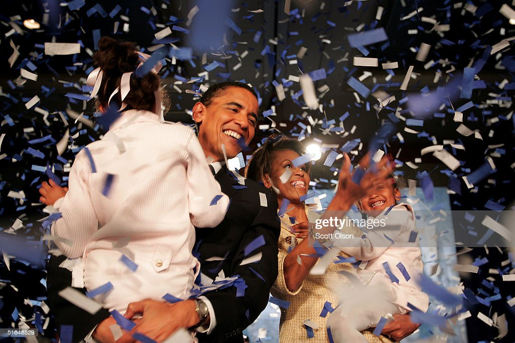 Candidate for the U.S. Senate Barack Obama (D-IL) and his daughter Malia (L), wife Michelle and youngest daughter Sasha (R) celebrate his victory with supporters over Repulican rival Alan Keyes November 2, 2004 in Chicago, Illinois. Obama was expected to easily defeat Keyes in this first ever senate race featuring two major-party African-American candidates.