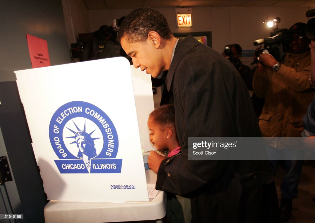 Candidate for the U.S. Senate Barack Obama casts his vote with the help of his daughter Malia November 2, 2004 in Chicago, Illinois. Obama is expected to win easily against Republican candidate Alan Keyes.