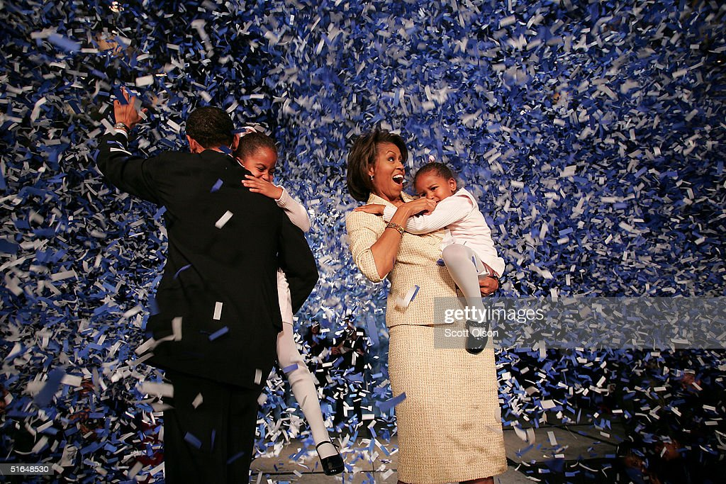 Candidate for the U.S. Senate Barack Obama (D-IL) (L) holding his daughter Malia with wife Michelle and youngest daughter Sasha (R) celebrate his victory with supporters over Repulican rival Alan Keyes November 2, 2004 in Chicago, Illinois. Obama was expected to easily defeat Keyes in this first ever senate race featuring two major-party African-American candidates.