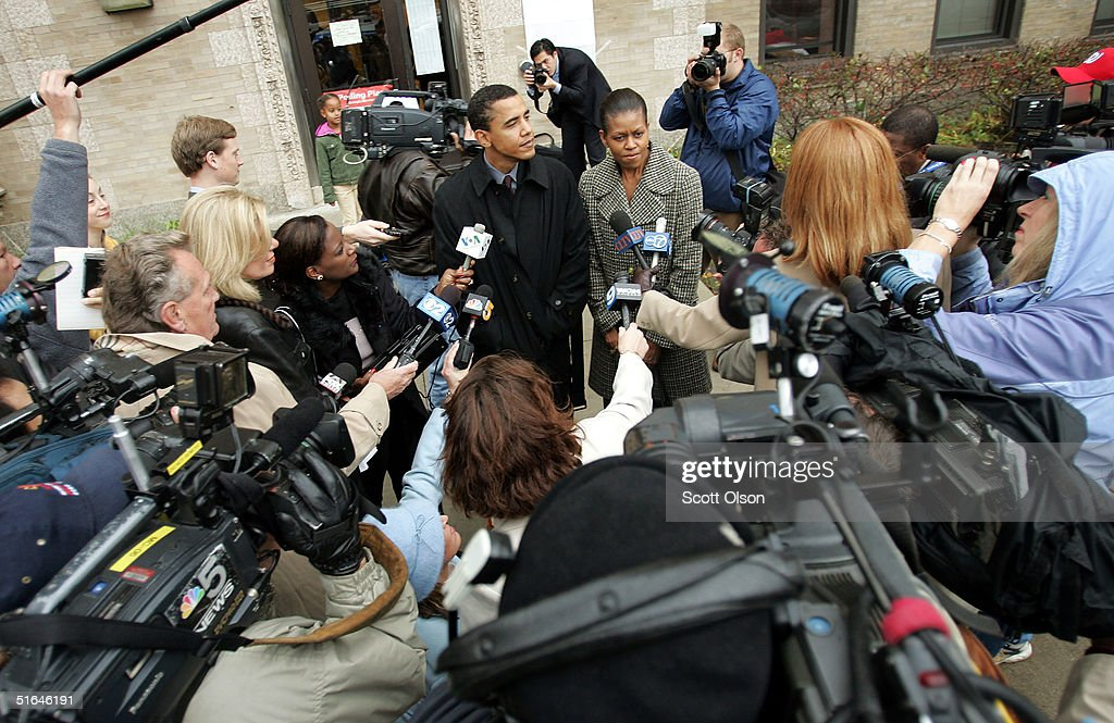 Candidate for the U.S. Senate Barack Obama (C) speaks to news reporters, with his wife Michelle at his side, outside his polling place after voting November 2, 2004 in Chicago, Illinois. Obama is expected to win easily against Republican candidate Alan Keyes.