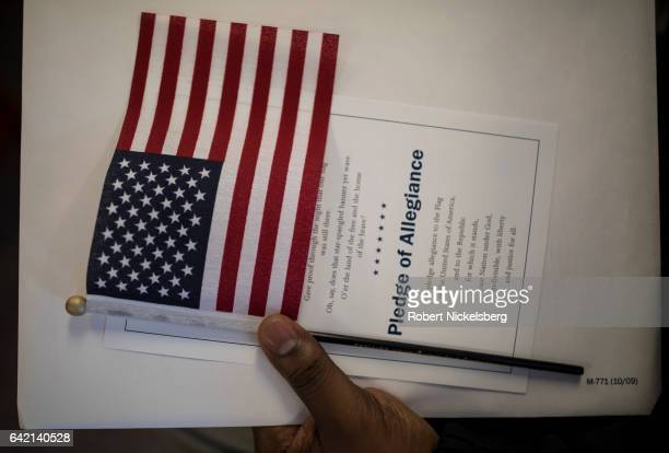 A candidate for US citizenship holds a US flag during a naturalization ceremony for new US citizens February 16 2017 in Newark New Jersey Eightynine...