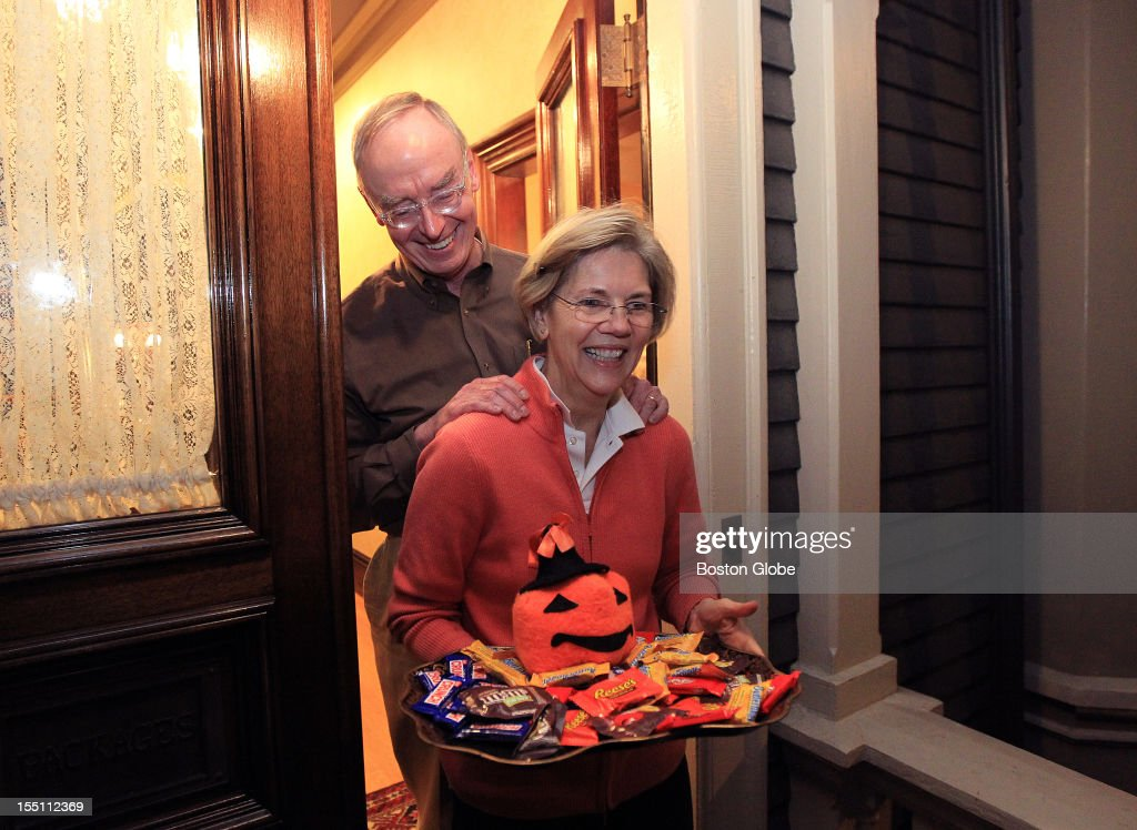 Candidate for U.S. Senate Elizabeth Warren and her husband, Bruce Mann, hand out candy to trick-or-treaters at their Cambridge home on Halloween.