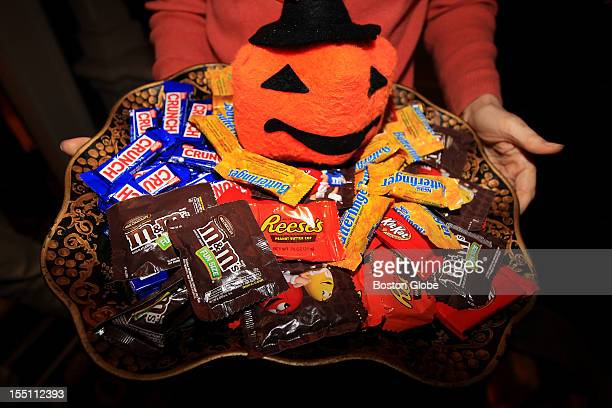 Candidate for US Senate Elizabeth Warren hands out candy to trickortreaters at her Cambridge home on Halloween