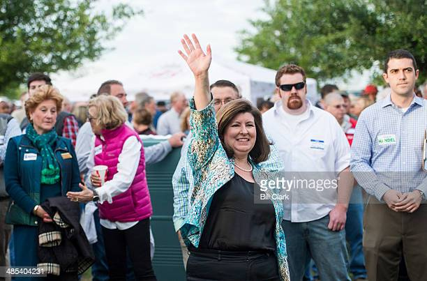 Candidate for US Senate Karen Handel waves to the crowd as she is introduced at the Law Enforcement Cookout at Wayne Dasher's pond house in...