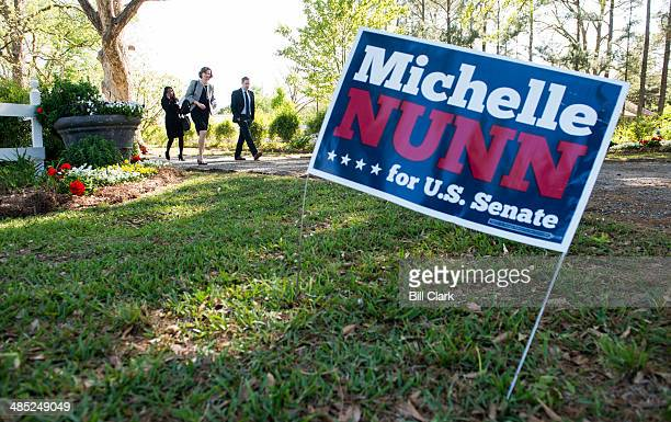 Candidate for US Senate Michelle Nunn leaves her meet and greet event in Shellman Ga on Wednesday April 16 2014