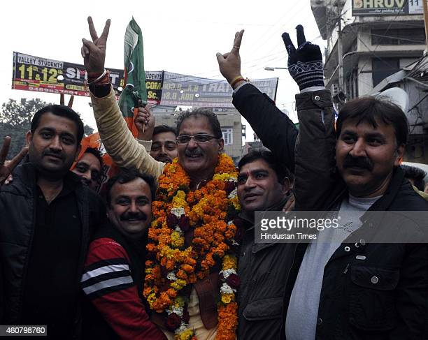 BJP candidate from Gandhi Nagar seat Kavinder Gupta gestures after his victory in Jammu And Kashmir assembly elections on December 23 2014 in Jammu...