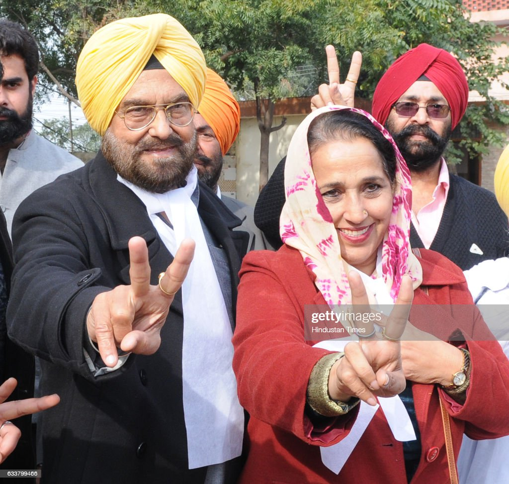 AAP candidate from Kharar Kanwar Sandhu with his wife showing marked finger after casting his vote at polling station Kansal village on February 4...