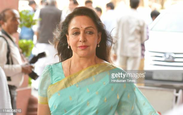BJP candidate Hema Malini arrives to attend the NDA Parliamentary Party meeting at Central Hall Parliament House on May 25 2019 in New Delhi India...