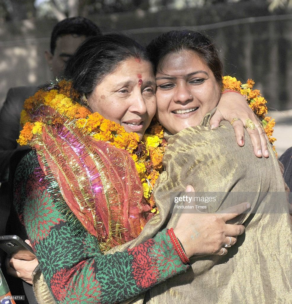 BJP candidate Hira Negi in light moment with SAD candidate Balwinder Kaur from ward no 15 at counting center in sector 46 on December 20 2016 in...