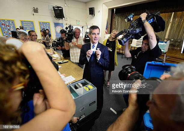 Candidate in the Los Angeles City mayoral race Councilman Eric Garcetti shows his ballot stub after voting in the Los Angeles Mayoral runoff race at...