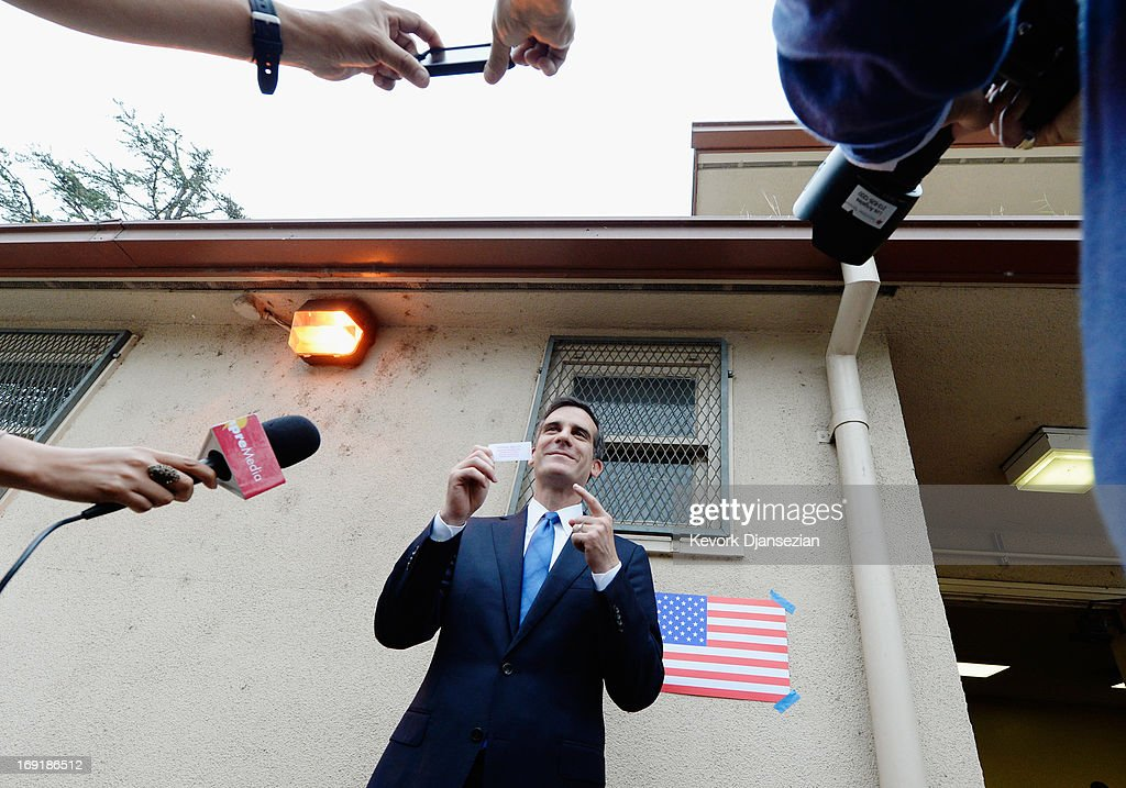 Candidate in the Los Angeles City mayoral race, Councilman Eric Garcetti shows his ballot stub after voting in the Los Angeles Mayoral run-off race at Allesandro Elementary School on May 21, 2013 in the Silver Lake area of Los Angeles, California. In what could be a record-low voter turnout, Garcetti is up against Los Angeles City Controller Wendy Greuel for the seat held by two-term mayor Antonio Villaraigosa.