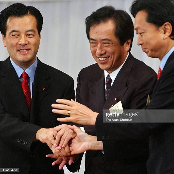 Candidate Katsuya Okada newlyelected Democratic Party of Japan President Naoto Kan and former president Yukio Hatoyama shake hands during the DPJ...