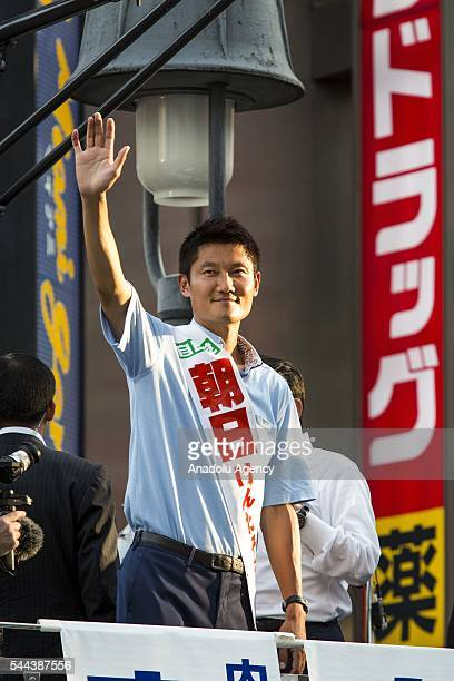 Candidate Kentaro Asahi salutes the voters during the July 10 Upper House election campaign at Shibuya crossing in Tokyo Japan on July 3 2016