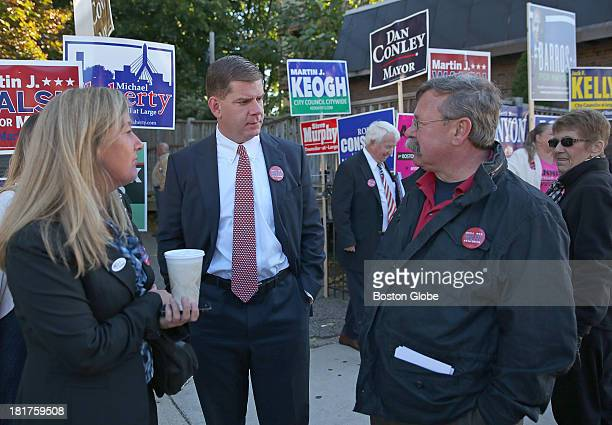 Candidate Marty Walsh center speaks with his friend Buddy Christopher right and Lorrie Higgins left outside the Cristo Rey School where Walsh voted...