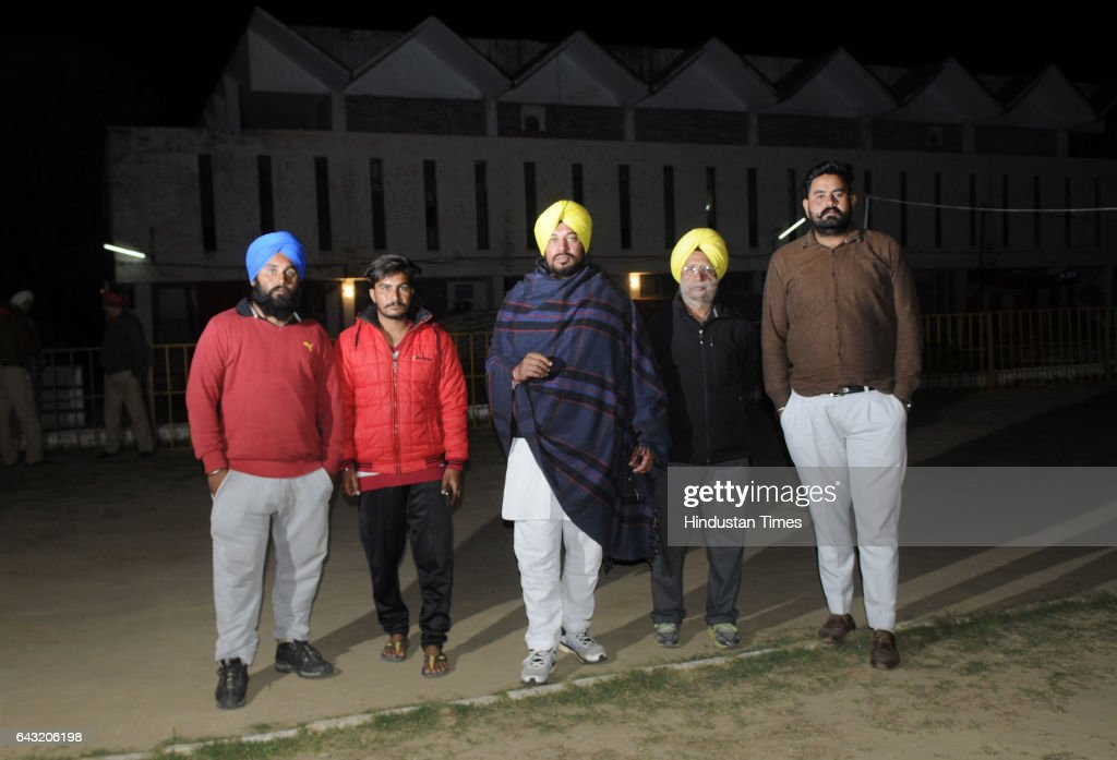 AAP candidate Nabha Gurdev Singh Mann with party workers guards outside a sealed 'strong room' where Electronic Voting Machines are kept at Go