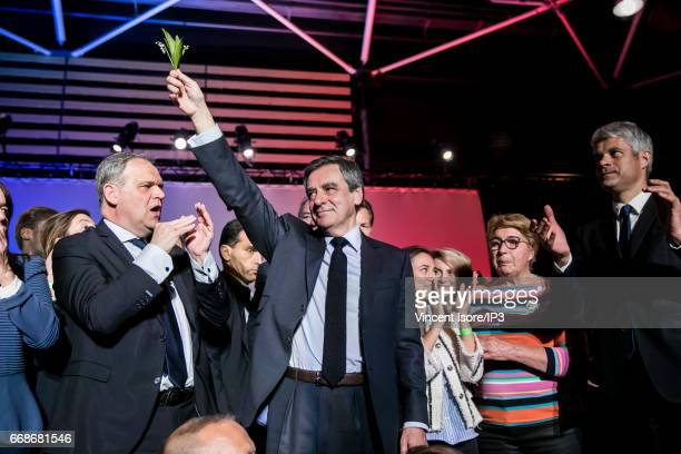Candidate of Les Republicains right wing Party for the 2017 French Presidential Election Francois Fillon holds a meeting near Lyon city on April 12...