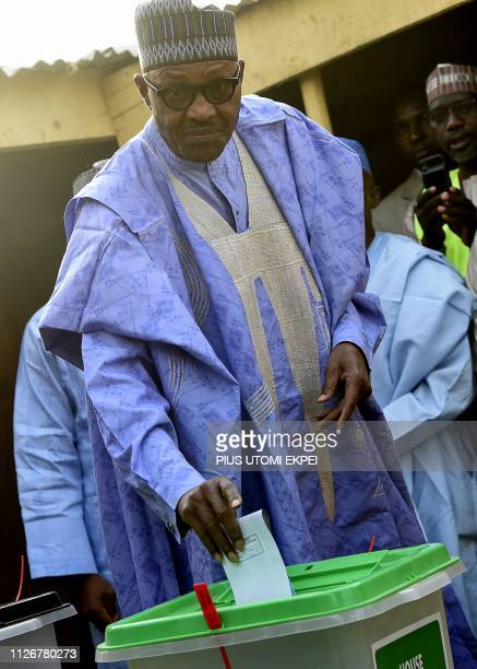 Candidate of the All Progressives Congress and incumbent President Muhammadu Buhari casts his vote at a polling station in his native hometown Daura...