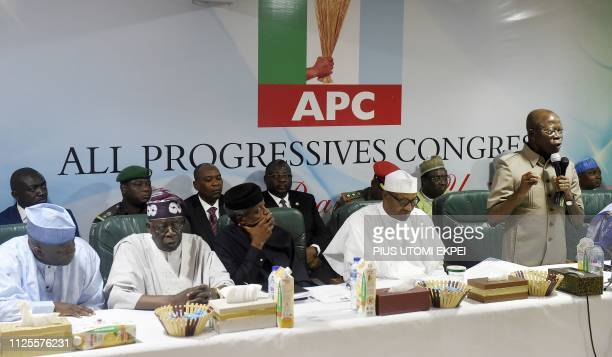 Candidate of the All Progressives Congress President Mohammadu Buhari sits as party chairman Adams Oshiomhole speaks while Zamfara State Governor...