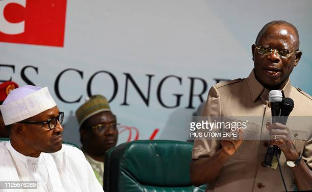 Candidate of the All Progressives Congress President Mohammadu Buhari looks on as party chairman Adams Oshiomhole speaks during the party caucus...