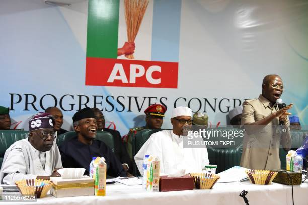 Candidate of the All Progressives Congress president Mohammadu Buhari sit next to party national leader Bola Tinubu and vicepresident Yemi Osinbajo...