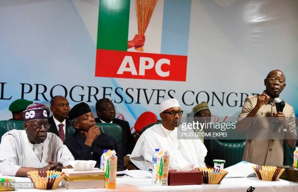 Candidate of the All Progressives Congress President Mohammadu Buhari sits as party chairman Adams Oshiomhole speaks while party national leader Bola...