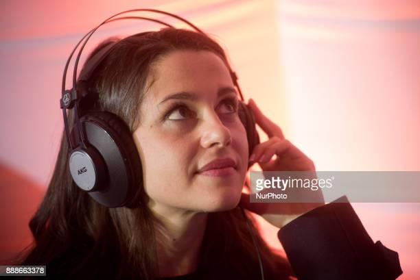 Candidate of the Ciutadans party Ines Arrimadas puts on headphones during a visit to a Ciudadanos election campaign stand on 8 December 2017 in...