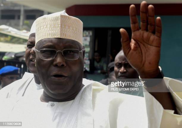 Candidate of the opposition Peoples Democratic Party Atiku Abubakar waves as he arrives to attend an emergency National Executive Committee party...