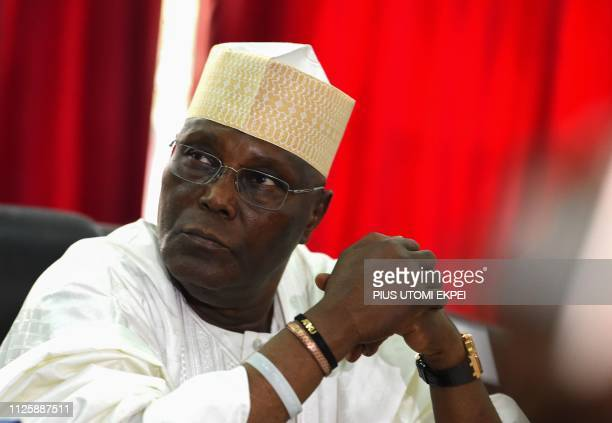 Candidate of the opposition Peoples Democratic Party Atiku Abubakar speaks with PDP Chairman of Board of Trustees Walid Jibrin as they attend an...