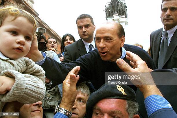 Candidate Prime Minister Silvio Berlusconi acknowledges the crowd in the streets of Tatanto for his electoral campaign in Southern Italy on May 5...