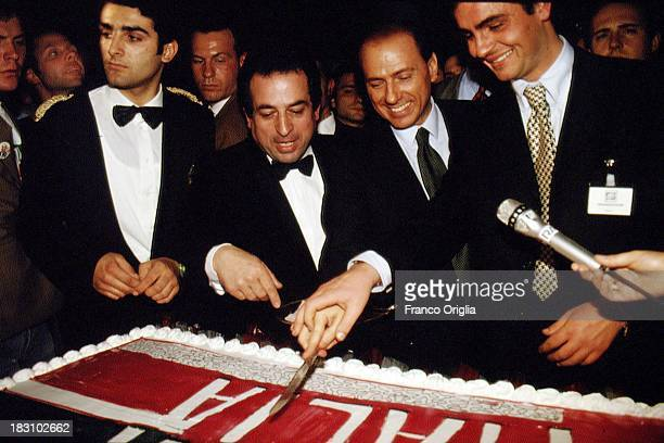 Candidate Prime Minster Silvio Berlusconi slices a cake during a party of 'Forza Italia' held after his TV debate on March 23 1994 in Rome Italy