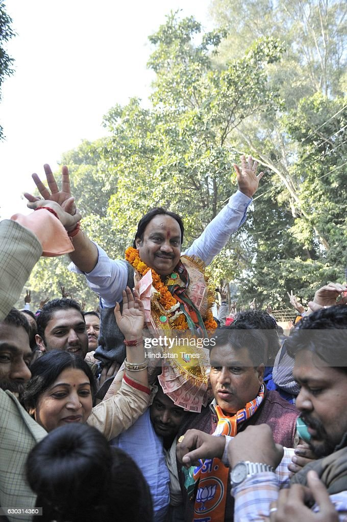BJP candidate Satish Kainth from ward no 11 celebrates his victory with supporters at sector 42 outside one of the counting center on December 20...