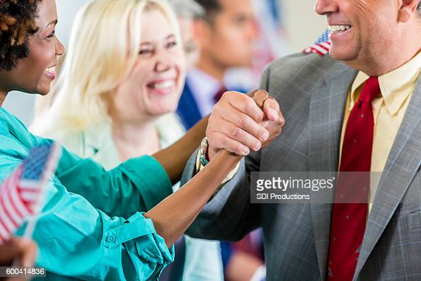 Candidate shaking supporter's hand during local political rally
