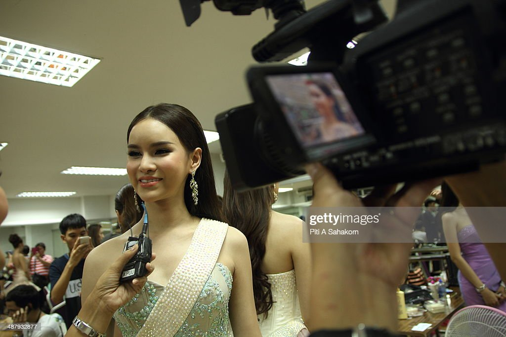 A candidate speaks with the media backstage of the Miss Tiffany Universe contest 2014 in Pattaya. This year marked the 40th anniversary of the Tiffany's show in Pattaya and this was the 16th Miss Tiffany Universe contest with all of the transsexual or transvestite contestants, aiming to promote human rights for the trans-gender population in Thailand.