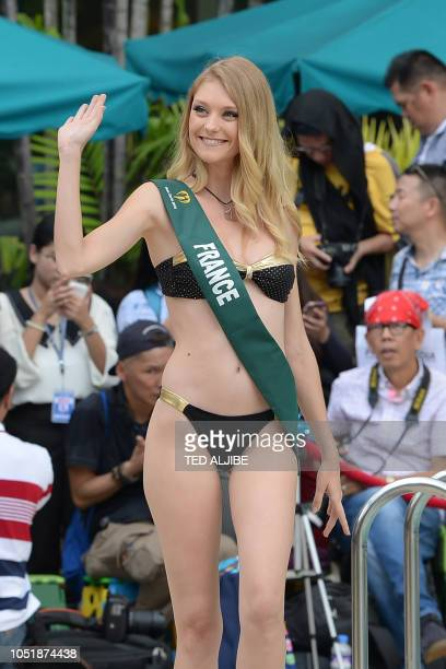 Candidate to the Miss Earth beauty pageant Allison Dernard of France poses for photos during a press presentation in Manila on October 11 2018 Some...